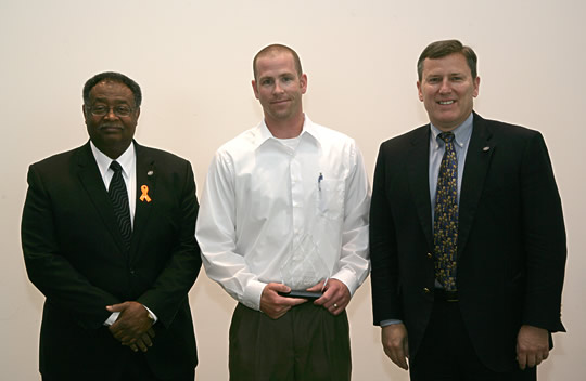 Sean T. Connaughton, the Virginia Secretary of Transportation and VDOT Commissioner, Greg Whirley presenting award to Kevin Baggett